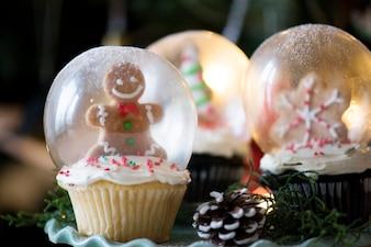 Set of Christmas cupcake snow globes