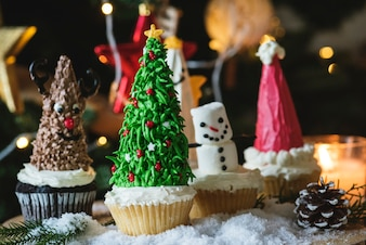 Set of cute Christmas cupcakes