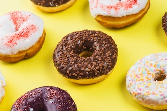 Set of delicious sweet donuts with colorful coating