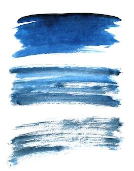 흰색 배경에 고립 된 다른 파란색 브러시 획의 집합입니다. 디자인 요소