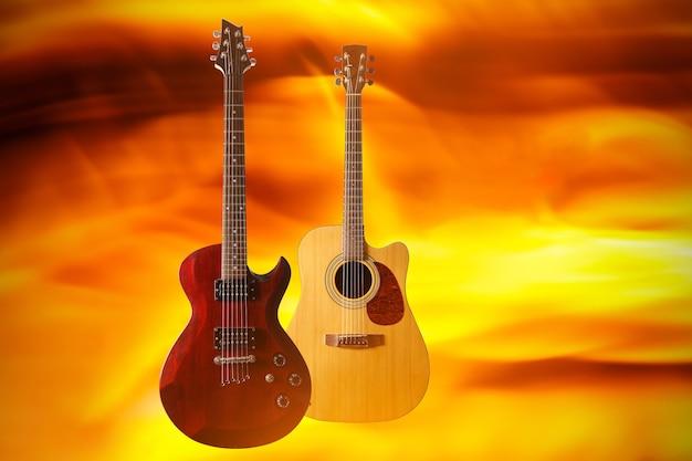 화재 배경에 전기 및 어쿠스틱 기타 세트.