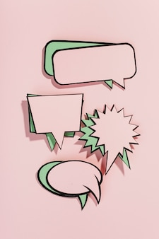 Set of empty comic speech bubbles on pink backdrop