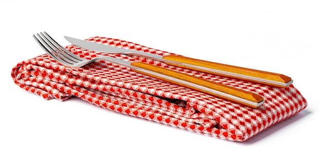 Набор вилка и нож на полотенце. изолированные на белом фоне вид сверху.