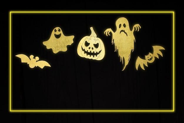 휴일 파티에 대 한 할로윈 황금 네온 할로윈 기호 집합입니다. 어두운 나무 배경 위에 황금색 유행의 무서운 호박, 거미, 박쥐, 유령, 미라.