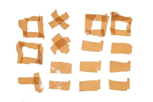 白い背景で隔離の茶色のスコッチの断片のセット