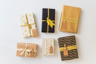 Set of present boxes in wraps with labels