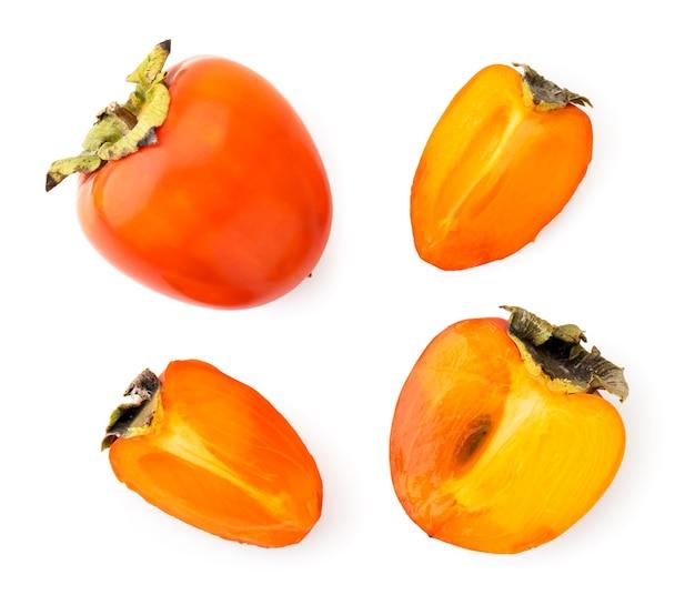 熟した柿、半分とスライスのセット。上面図。