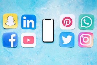 Set of social networking icons placed near smartphone