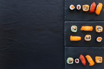 Set of sushi and rolls on boards