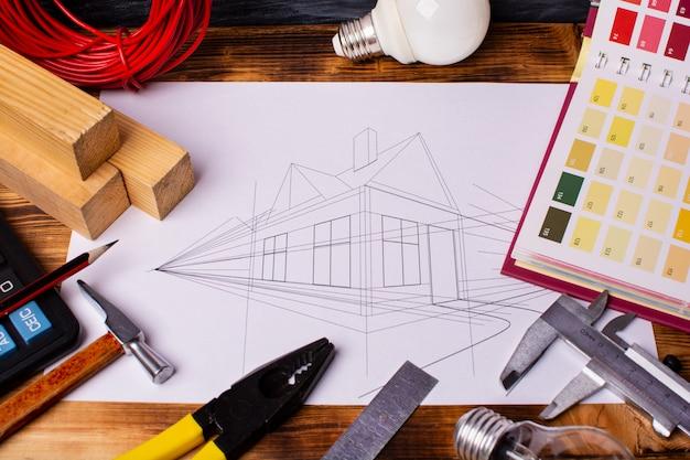 ツールのセットと家の図面