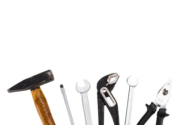ツールのセット、白の多くのツール。コピースペース付き
