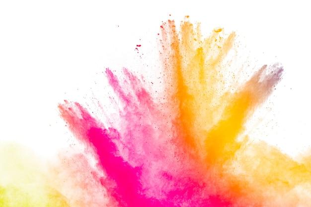白い背景の上の変種色の粉末爆発のセット。カラフルな粉塵爆発。