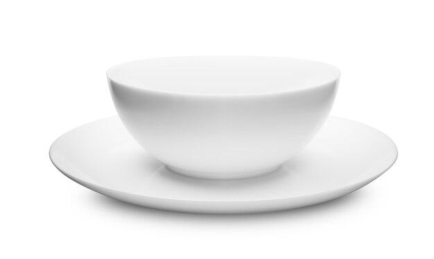 明るい背景のテーブルの上の白い皿のセットです。クリップピッグパス付き
