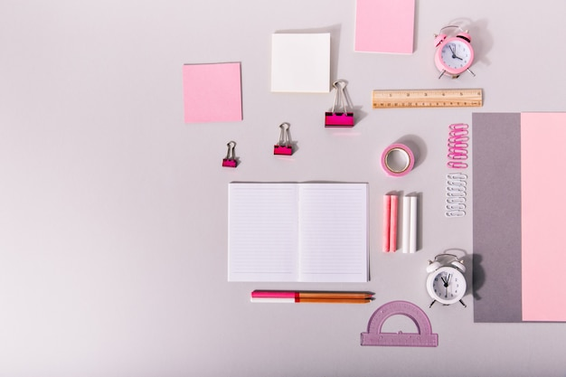 Set of office supplies for work in pastel pink colors on isolated.