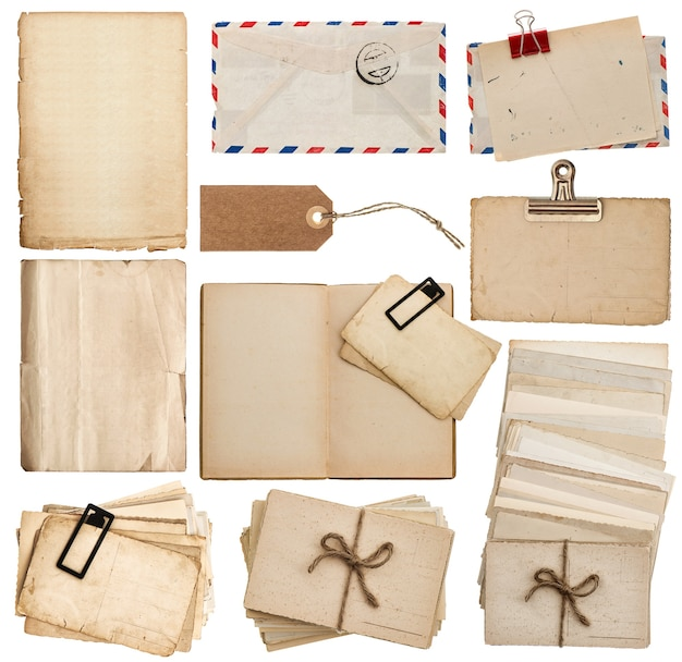 Set of old paper sheets, book, envelope, postcards, tags isolated on white background