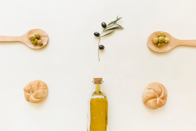 Set of olive oil bottle olives and bread