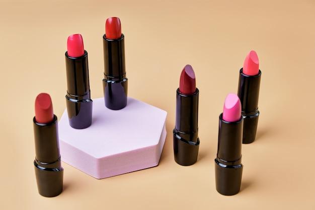Set of open lipsticks on trendy pedestal