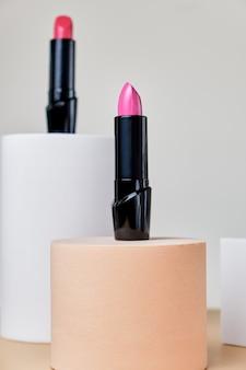 Set of open lipsticks on trendy pedestals