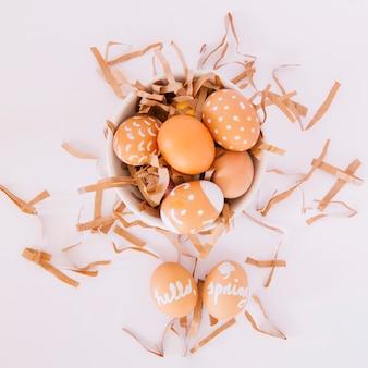 Set of orange easter eggs in bowl