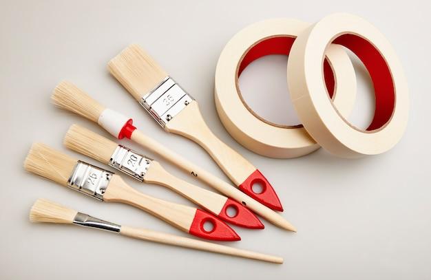 Set of painting brushes and masking tape