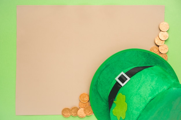 Set of paper near coins and saint patricks hat