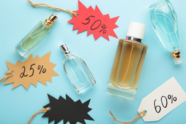 Set of perfume for sale on black friday on blue background. top view