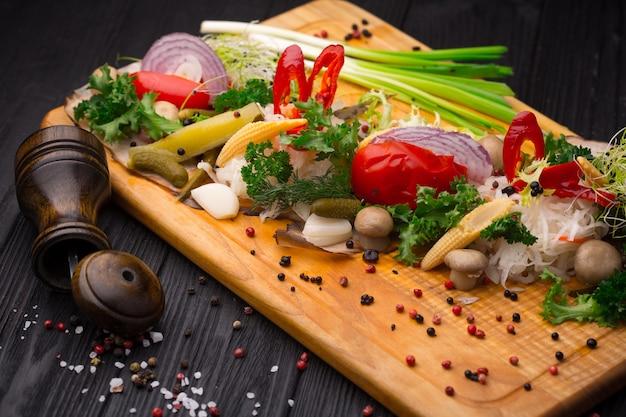 Set of pickled vegetables on black