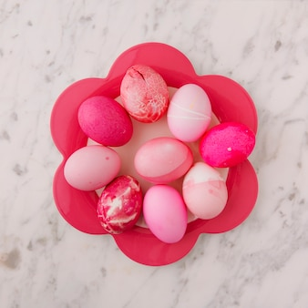 Set of pink easter eggs on plate