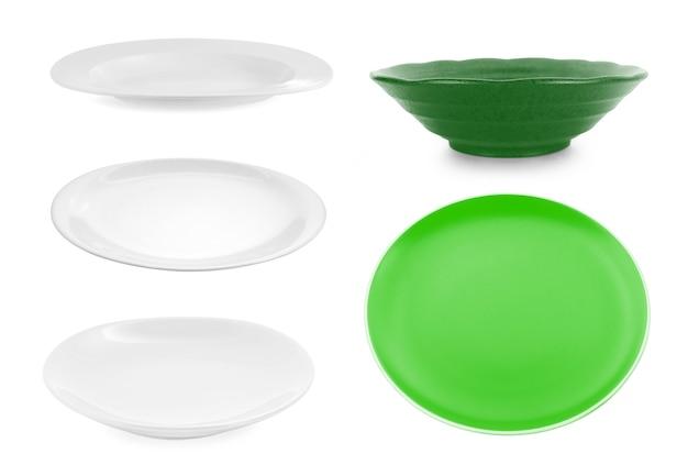 Set of plates on white background