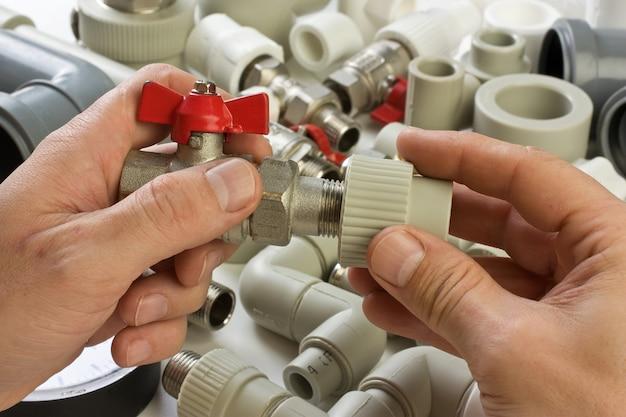 Set plumbing fittings in his hand