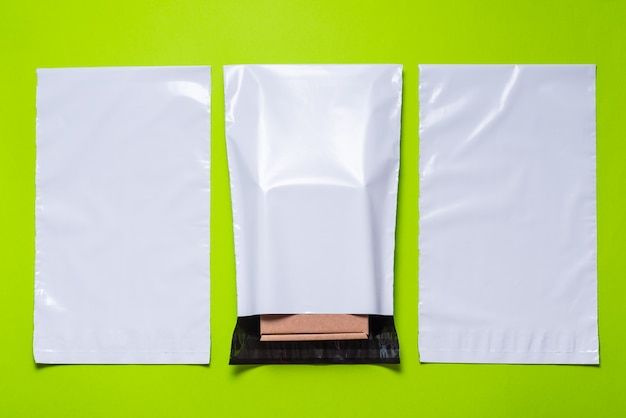 Set of polythene envelopes on green background