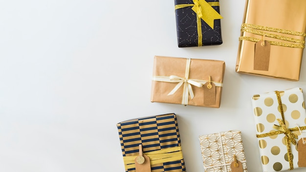 Set of present boxes in wraps with tags