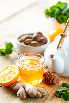 Set of products to boost the immune system. honey, lemon, nuts, ginger to immunity boosting. copy space