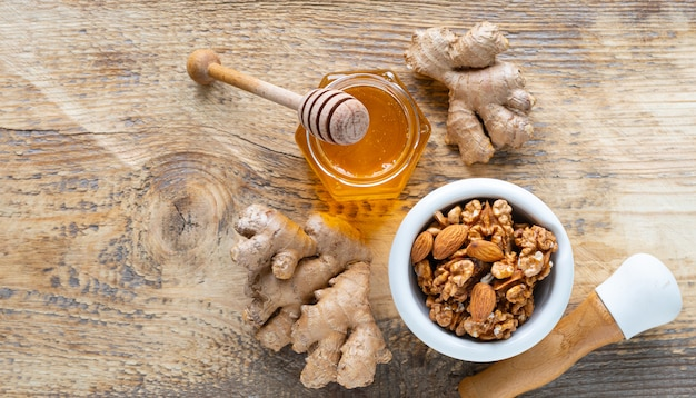 Set of products to boost the immune system. honey, nuts, ginger to immunity boosting. top view. copy space