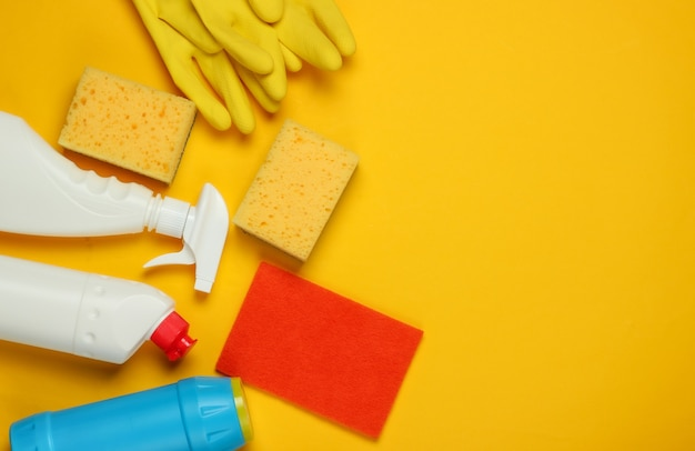 Set of products for cleaning the house on a yellow background. top view. copy space