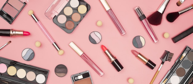 Set of professional cosmetics, makeup tools and accessories on pink background, beauty, fashion, shopping concept, flat lay. high quality photo