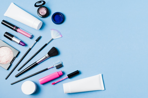 Set of professional decorative cosmetics on light surface