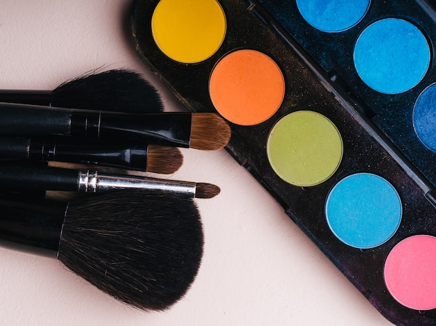 Set of professional makeup brushes and a palette