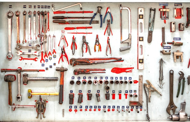 Set of professional mechanic tools hanging on a wall