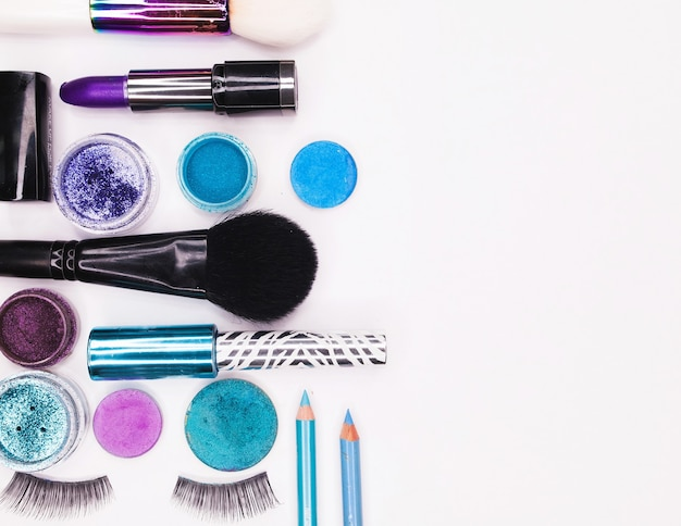 A set of professional multi-colored cosmetics for make-up on a white background