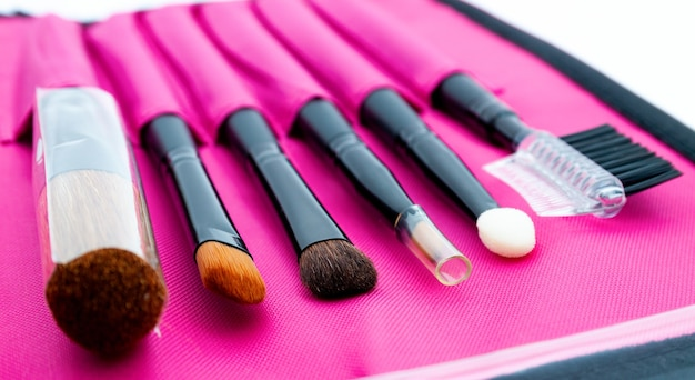 A set of professional tools for face makeup in a bright pink case