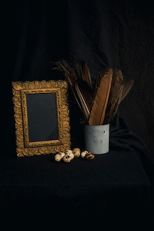 Set of quail eggs near feathers in can and photo frame