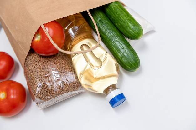 Set of raw cereals, grains, pasta and canned food on a white table. copy space, flat lay. crisis food stock for coronavirus quarantine isolation period. food delivery, donation