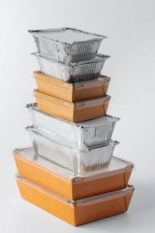 Set of recyclable food packaging on white background