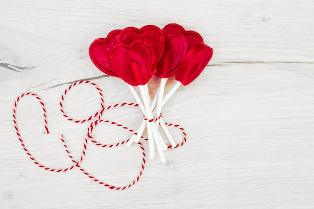 Set of red lollipops on sticks with thread