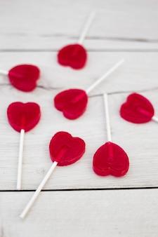 Set of red lollipops on sticks