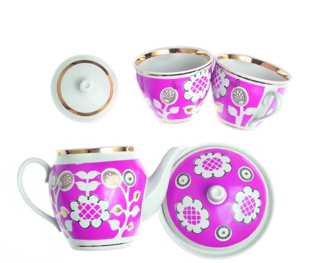 Set of retro ceramic cups with patterns, teapots, sugar bowl isolated