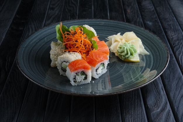 Set of rolls with salmon, cesame and spicy carrot