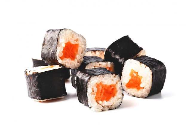 Set of rolls with salmon and philadelphia cheese on a white surface.