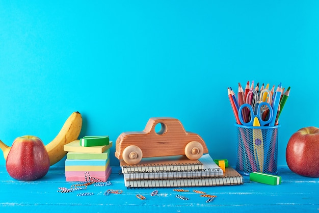 Set of school supplies with notebook, pencils, stickers, paper clips, scissors